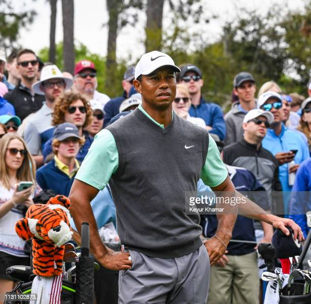 Tiger Woods waits to tee off on the 10th hole during the third round of THE PLAYERS Championship on the Stadium Course at TPC Sawgrass on March 16...