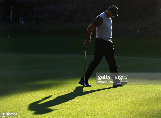 Tiger Woods walks across the 12th hole during the first round of the Genesis Open at Riviera Country Club on February 15 2018 in Pacific Palisades...