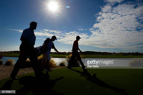 Tiger Woods walks along the 18th hole during the final round of the Hero World Challenge at Albany course on December 4 2016 in Nassau Bahamas