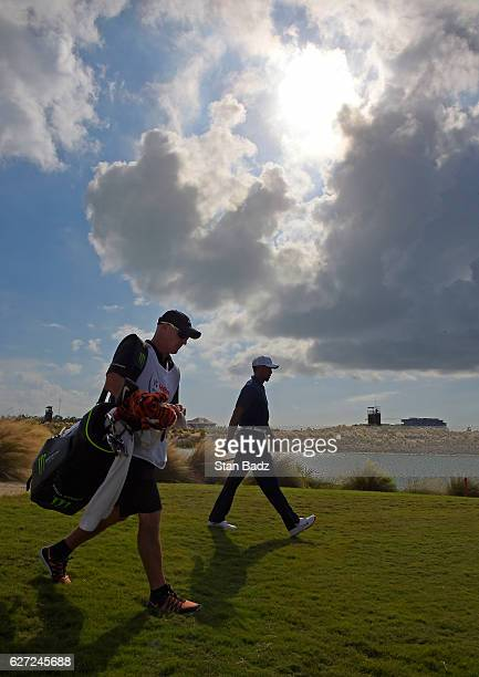 Tiger Woods walks along the 18th hole during the second round of the Hero World Challenge at Albany course on December 2 2016 in Nassau Bahamas