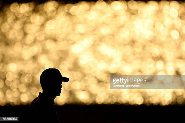 Tiger Woods walks down the fairway of the 18th hole during the second round of THE PLAYERS Championship on THE PLAYERS Stadium Course at TPC Sawgrass...