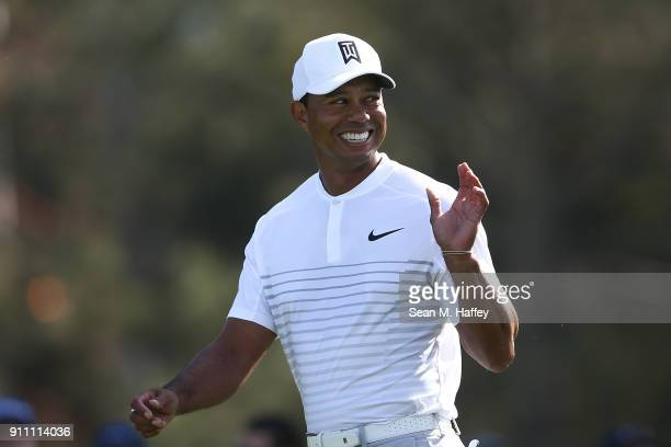 Tiger Woods walks down the fairway on the 14th hole during the third round of the Farmers Insurance Open at Torrey Pines South on January 27 2018 in...