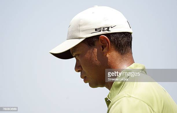 Tiger Woods walks down the first fairway during the third round of the 89th PGA Championship at the Southern Hills Country Club on August 11 2007 in...