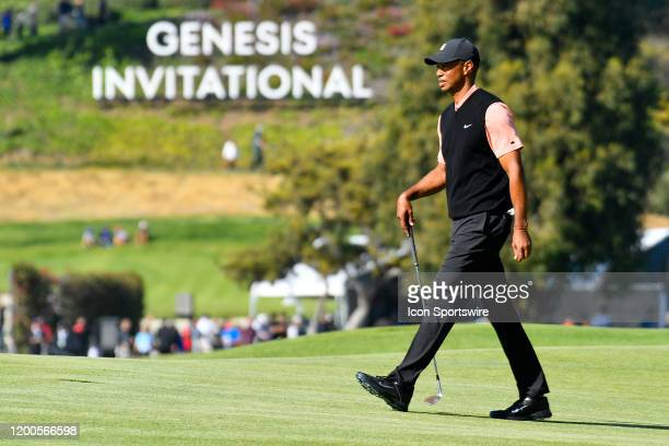 Tiger Woods walks in from the of the Genesis Invitational sign during the first round of The Genesis Genesis Invitational golf tournament at the...