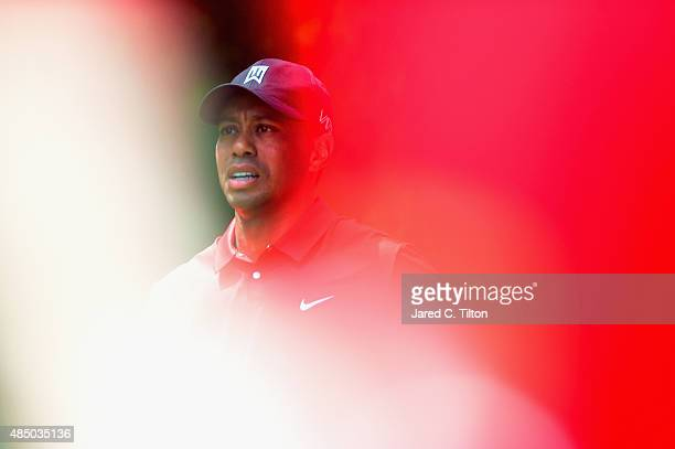 Tiger Woods walks off of the second tee box during the final round of the Wyndham Championship at Sedgefield Country Club on August 23, 2015 in...