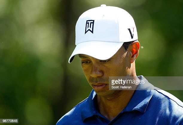 Tiger Woods walks off the 12th tee during the second round of the 2010 Quail Hollow Championship at the Quail Hollow Club on April 30, 2010 in...