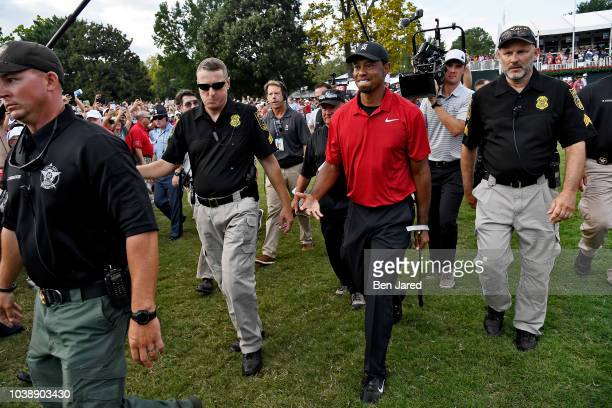 Tiger Woods walks off the 18th green to sign his score card after the final round of the TOUR Championship at East Lake Golf Club on September 23 in...