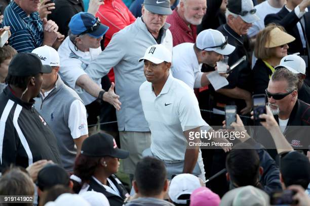 Tiger Woods walks off the course after finishing his round during the second round of the Genesis Open at Riviera Country Club on February 16 2018 in...