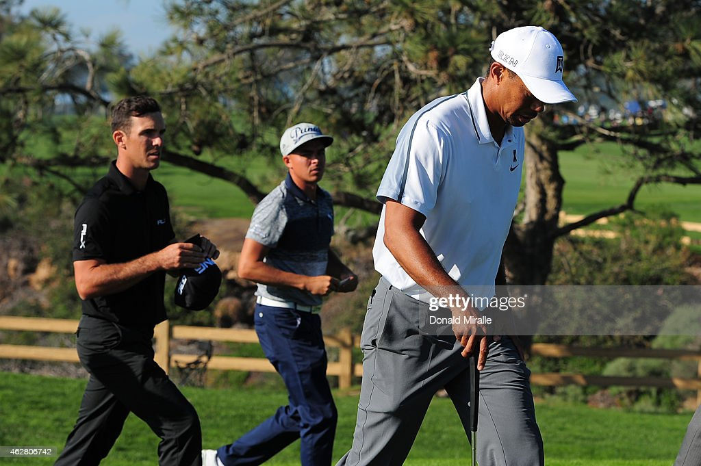 Tiger Woods walks off the course after withdrawing from the Farmers Insurance Open due to injury at Torrey Pines Golf Course on February 5, 2015 in La Jolla, California.