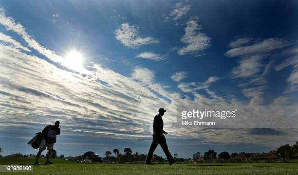 Tiger Woods walks off the fifth hole during the third round of the Honda Classic at PGA National Resort and Spa on March 2, 2013 in Palm Beach...