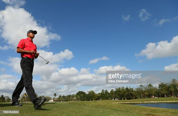 Tiger Woods walks off the ninth tee during the final round of the World Golf ChampionshipsCadillac Championship at the Trump Doral Golf Resort Spa on...