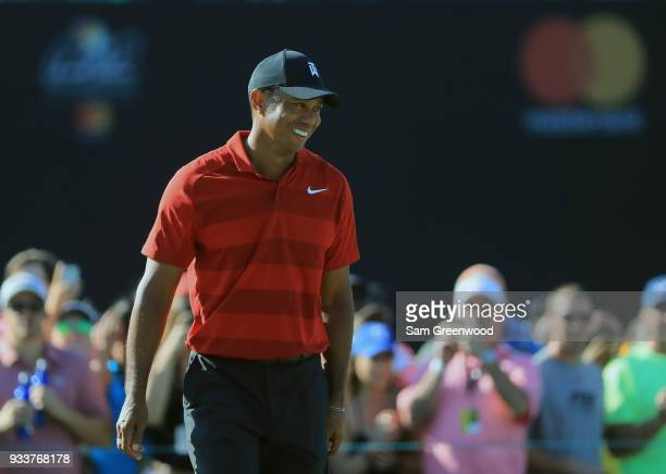 Tiger Woods walks onto the green during the final round at the Arnold Palmer Invitational Presented By MasterCard at Bay Hill Club and Lodge on March...