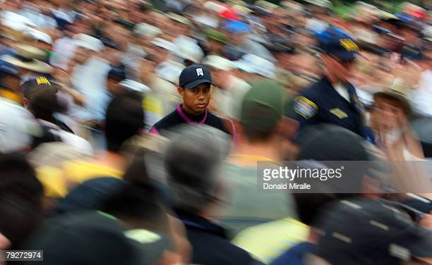 Tiger Woods walks through the gallery during the third round of the Buick Invitational on January 26, 2008 at the Torrey Pines Golf Course in La...