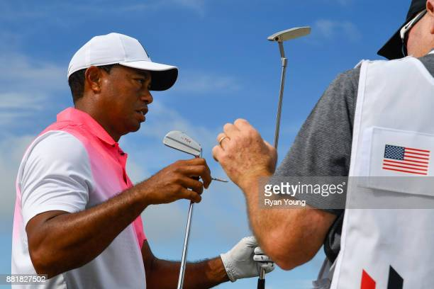 Tiger Woods walks to his bag following a shot during practice for the Hero World Challenge at Albany course on November 29 2017 in Nassau Bahamas