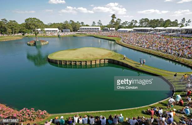 Tiger Woods walks to the 17th green during the third round of THE PLAYERS Championship on THE PLAYERS Stadium Course at TPC Sawgrass held on May 9,...