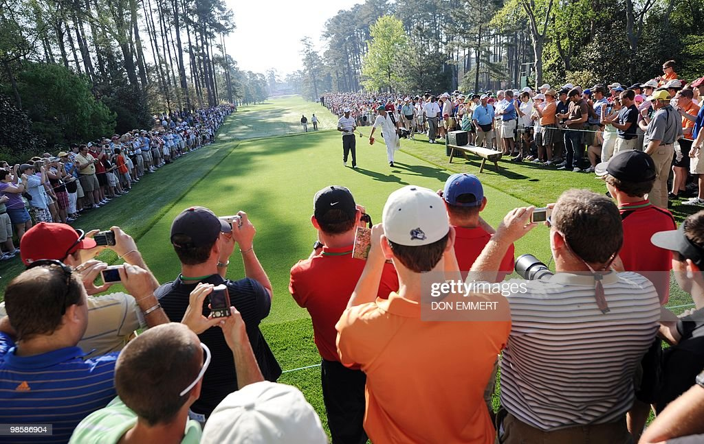 Tiger Woods walks to the tee during a practice round at the Masters golf tournament at Augusta National Golf Club April 5, 2010 in Augusta, Georgia. Woods received a friendly reception in a Monday morning practice round at the Masters, his first public golf appearance since the sex scandal that overtook him last November.