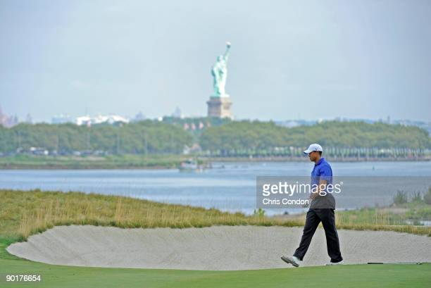 Tiger Woods walks up the 18th fairway during the third round of The Barclays at Liberty National Golf Club on August 29, 2009 in Jersey City, New...
