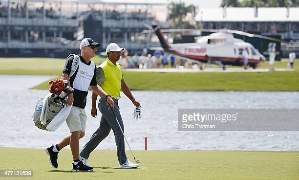 Tiger Woods walks with his caddie Joe LaCava on the tenth hole during the second round of the World Golf ChampionshipsCadillac Championship at Trump...