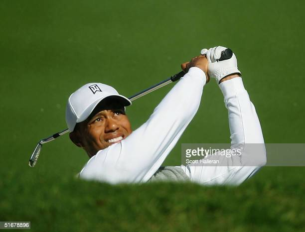 Tiger Woods watches a bunker shot on the fourth hole during the second round of PGA Tour Championship at East Lake Golf Club on November 5, 2004 in...