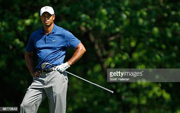 Tiger Woods watches a poor shot on the 13th hole during the second round of the 2010 Quail Hollow Championship at the Quail Hollow Club on April 30,...