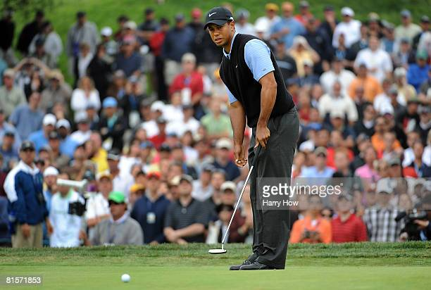 Tiger Woods watches a putt on the sixth hole during the third round of the 108th US Open at the Torrey Pines Golf Course on June 14 2008 in San Diego...