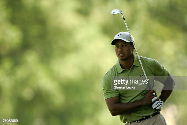 Tiger Woods watches a shot from the fairway on the first hole during the third round of the 89th PGA Championship at the Southern Hills Country Club...