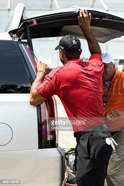 Tiger Woods watches as his vehicle is loaded after withdrawing on the ninth hole during the final round of the World Golf Championships-Bridgestone...