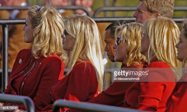 Tiger Woods watches entertainment from the second row during opening ceremonies at the 2004 Ryder Cup in Detroit Michigan September 16 2004 In front...