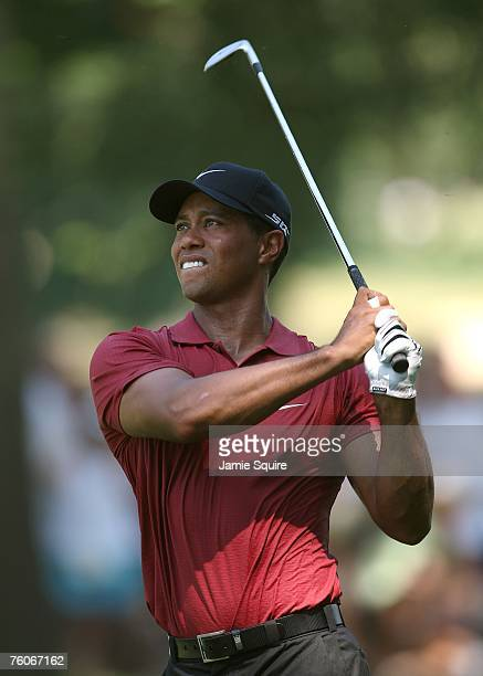 Tiger Woods watches his approach shot on the fifth hole during the final round of the 89th PGA Championship at the Southern Hills Country Club on...