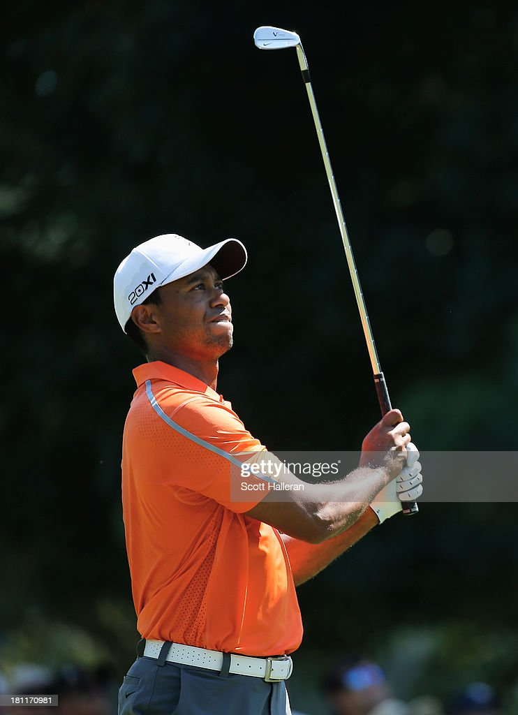 Tiger Woods watches his approach shot on the first hole during the first round of the TOUR Championship by Coca-Cola at East Lake Golf Club on September 19, 2013 in Atlanta, Georgia.