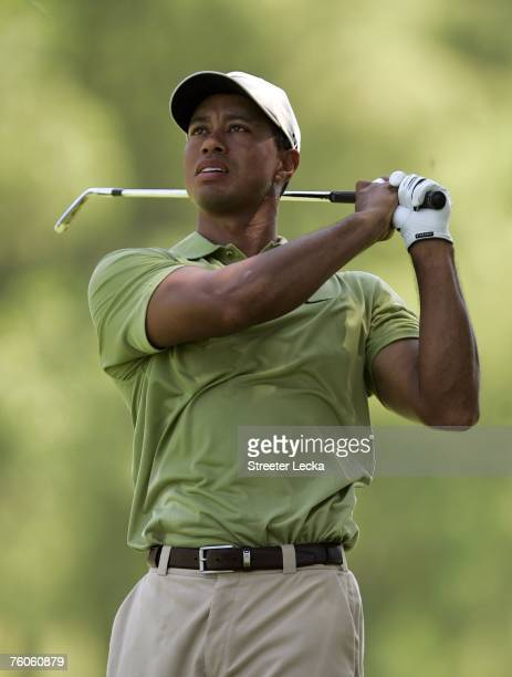 Tiger Woods watches his approach shot on the first hole during the third round of the 89th PGA Championship at the Southern Hills Country Club on...