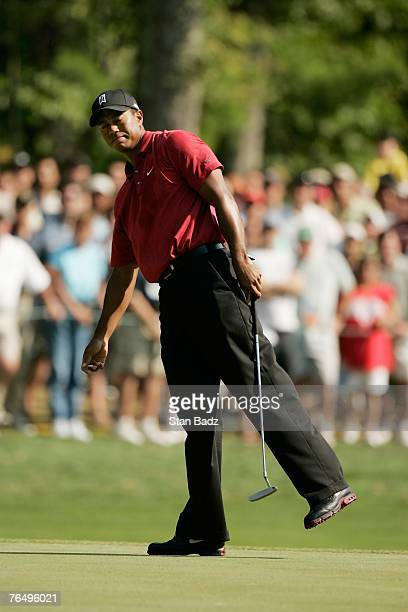 Tiger Woods watches his ball roll past the cup during the fourth round of the Deutsche Bank Championship, the second event of the new PGA TOUR...