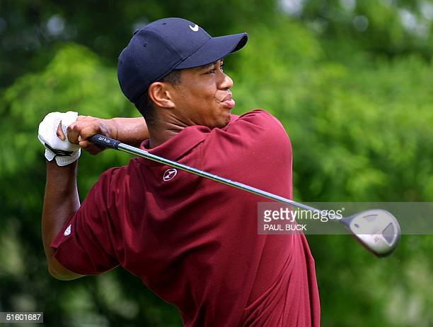 Tiger Woods watches his drive on number four during the final round of the Byron Nelson Classic at the TPC Four Seasons in Irving, Texas 13 May 2001....