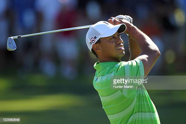 Tiger Woods watches his second shot on the 12th hole during the second round of the AT&T National at Aronimink Golf Club on July 2, 2010 in Newtown...