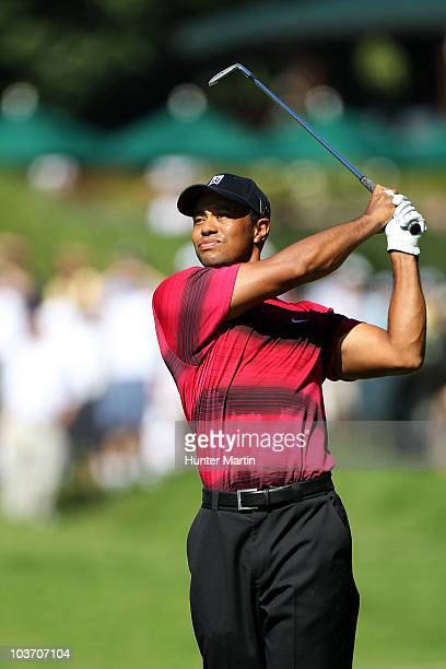 Tiger Woods watches his second shot on the first hole during the final round of The Barclays at the Ridgewood Country Club on August 29 2010 in...