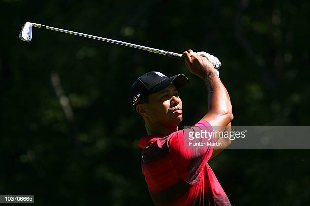Tiger Woods watches his second shot on the fourth hole during the final round of The Barclays at the Ridgewood Country Club on August 29 2010 in...