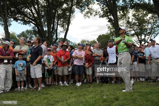Tiger Woods watches his second shot out of the rough on the sixth hole during the second round of the AT&T National at Aronimink Golf Club on July 2,...