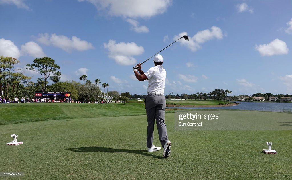Tiger Woods watches his tee shot fly on the 18th on Wednesday, Feb. 21, 2018 during the Pro-Am round of the Honda Classic at the PGA National in Palm Beach Gardens, Fla.