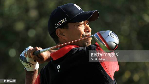 Tiger Woods watches his tee shot on the 11th hole during the final round of the Chevron World Challenge at Sherwood Country Club on December 4, 2011...