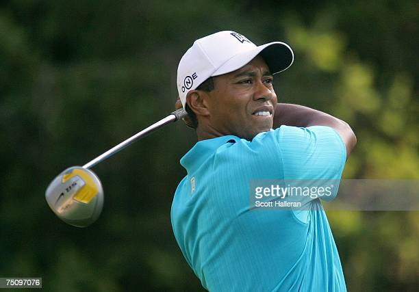Tiger Woods watches his tee shot on the 11th tee during the second round of the AT&T National at Congressional Country Club on July 6, 2007 in...