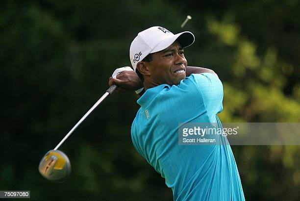 Tiger Woods watches his tee shot on the 11th tee during the second round of the ATT National at Congressional Country Club on July 6 2007 in Bethesda...