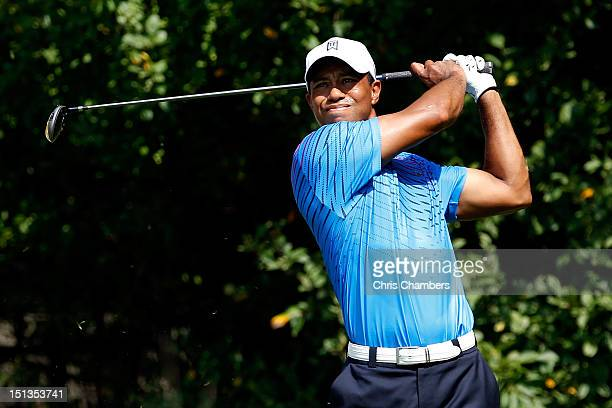 Tiger Woods watches his tee shot on the 12th hole during the first round of the BMW Championship at Crooked Stick Golf Club on September 6 2012 in...