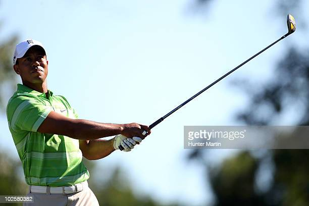 Tiger Woods watches his tee shot on the 12th hole during the second round of the AT&T National at Aronimink Golf Club on July 2, 2010 in Newtown...