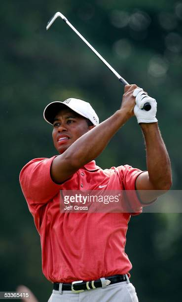 Tiger Woods watches his tee shot on the 12th hole during the second round of the 2005 PGA Championship at Baltusrol Golf Club on August 12, 2005 in...