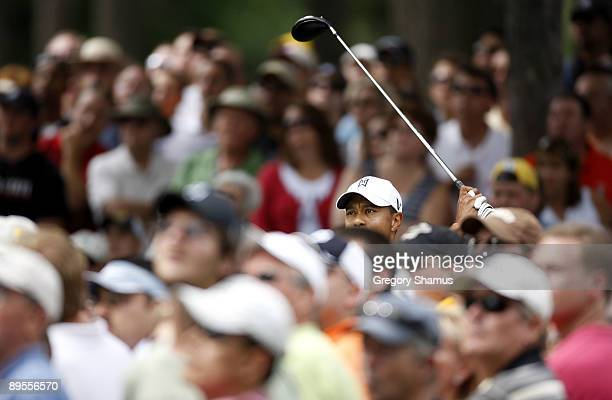 Tiger Woods watches his tee shot on the 12th hole during the third round of the Buick Open at Warwick Hills Golf and Country Club on August 1 2009 in...