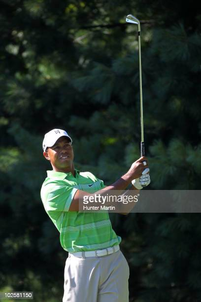 Tiger Woods watches his tee shot on the 13th hole during the second round of the AT&T National at Aronimink Golf Club on July 2, 2010 in Newtown...