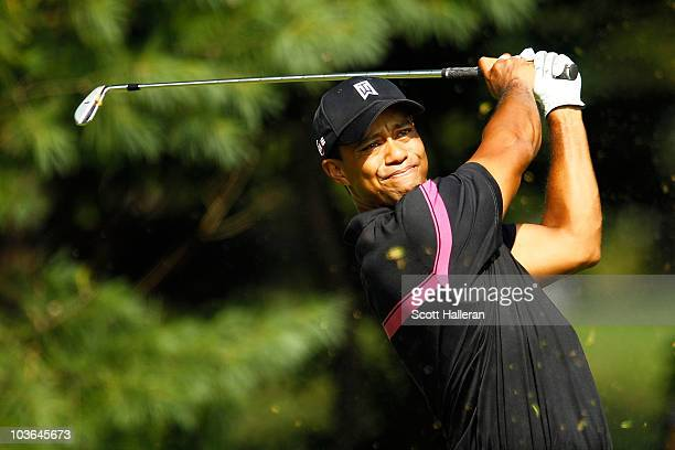 Tiger Woods watches his tee shot on the 14th hole during the first round of The Barclays at the Ridgewood Country Club on August 26 2010 in Paramus...