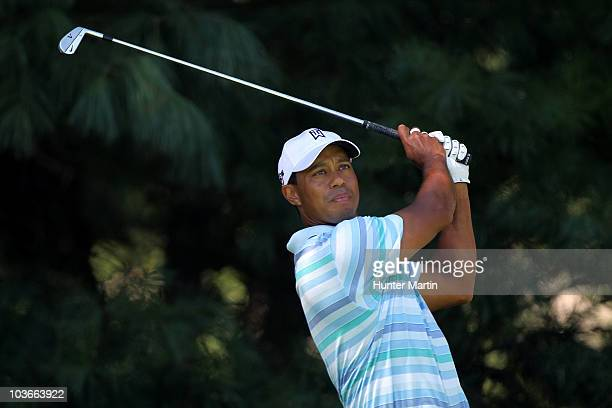 Tiger Woods watches his tee shot on the 14th hole during the second round of The Barclays at the Ridgewood Country Club on August 27 2010 in Paramus...
