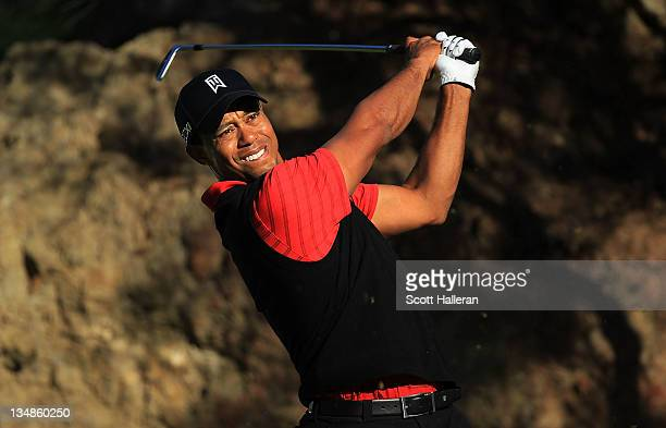 Tiger Woods watches his tee shot on the 15th hole during the final round of the Chevron World Challenge at Sherwood Country Club on December 4, 2011...