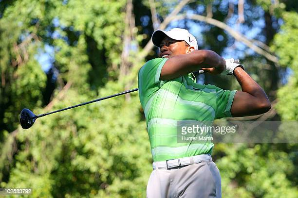 Tiger Woods watches his tee shot on the 15th hole during the second round of the AT&T National at Aronimink Golf Club on July 2, 2010 in Newtown...